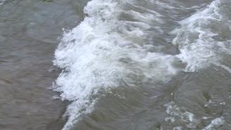 Watching the high water rushing along its way upstream